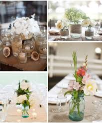 Wedding Table Decorations Jam Jars Top right 100 large arrangement and smaller one around the edge 2