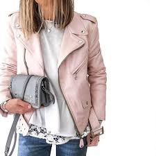 blue jeans a blush leather jacket a white lace top