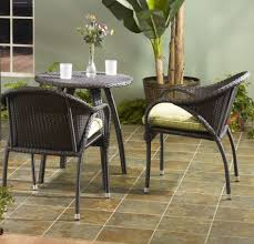 hampton bay patio furniture with mid century wicker chairs and round dining table plus interlocking pavers