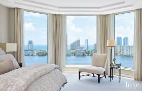 Contemporary Cream Bedroom with Floor-to-Ceiling Bay Windows - Luxe  Interiors + Design