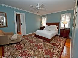 master bedroom with oriental rug and chaisetraditional bedroom