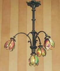 66 a bronze patinated solid brass french chandelier ca 1920 with four american handel like stained glass shades rewired and fitted with american
