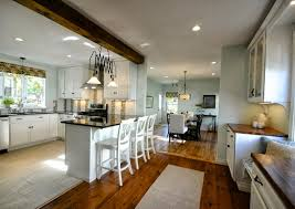open kitchen and dining room custom brown wooden wall storage rustic kitchen chandelier lighting white kitchen themed l shaped black wooden kitchen sets