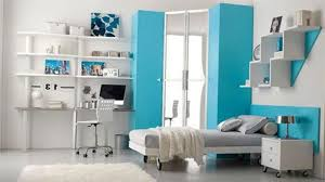 furniture for guys. Room Design Ideas For Men With Cool Blue And White Painting Feat Nice Graded Book Rack Guys Furniture