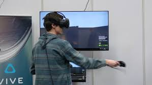 htc vive virtual reality video gaming system. hannover, germany - march, 2017: 4k video of man playing game in htc vive virtual reality gaming system
