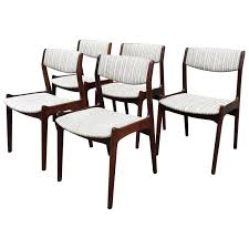 set of five danish modern rosewood dining chairs by eric buck