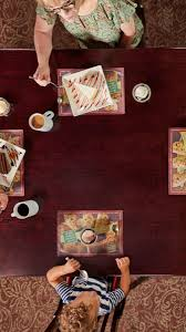 overhead view of family eating at old spaghetti factory