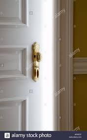 White Door With Fancy Gold Door Knob Slightly Open Bright White ...