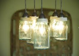 reclaimed lighting. Jenn Tracks Down Vintage Bubbled Glass Mason Jars And Turns Them Into Unique Light Fixtures. Check Out The Chandelier In Her Dining Room: Reclaimed Lighting