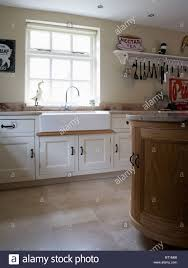 Limestone Flooring In Kitchen Belfast Sink Below Window In Cream Country Kitchen With Limestone