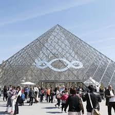 Image result for Macron in front of Mitterand's pyramid