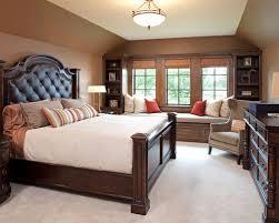 dark bedroom furniture. elegant carpeted bedroom photo in minneapolis with brown walls dark furniture n