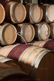stacked oak barrels maturing red wine. A Winemaker\u0027s Thief In An Oak Barrel Inside Of Winery Cellar Stacked Barrels Maturing Red Wine E