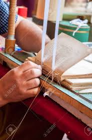 book binding process male worker binding pages repairing an old book bookbinder sweing