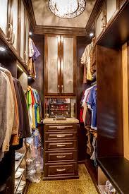 narrow man s walkin closet in wood