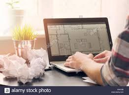 Interior Designer Laptop Architect Interior Designer Working On Laptop With Floor