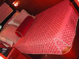Yacht Interiors   Mariya Interior Decor & Captain's cabin fitted quilted bedspread, pillows and faux Roman shade.  Private 95' yacht Adamdwight.com