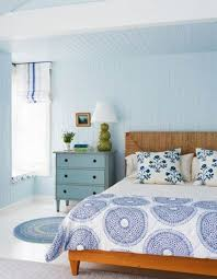 Beach Inspired Bedding Comfortable Beach Bedroom With Dark Blue Walls White Curtains And