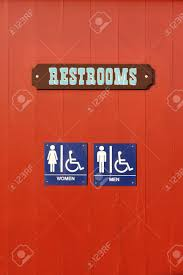 handicap bathroom sign. blue woman man handicapped restroom sign on red wall stock photo - 5647773 handicap bathroom