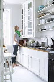 small kitchen storage ideas with simple stool and window