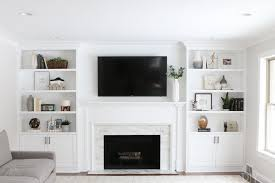 updating a white marble tile fireplace