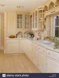 Neutral Kitchen Pale Neutral Kitchen With Distressed Paint On Cupboard Doors And