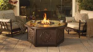 patio ideas with fire pit. Round Propane Fire Pit Table With Cream Patio Cushions In Chairs: Full Size Ideas