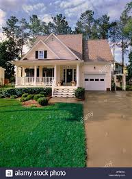 House With Black Trim Small Two Story Cream House With Black Shutters White Trim And A