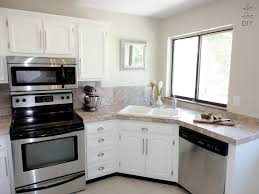 livelovediy how to paint kitchen cabinets in 10 easy steps pertaining to painting kitchen cabinets white