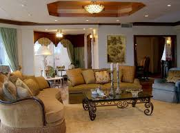fancy terranean style interior design living room with cream fabric sofa and black gloss top coffee table also cone table l shade