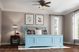 this hugger ceiling fan by hunter is shown in a bedroom