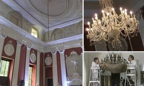 bungling workmen accidentally recreate scene from only fools and horses by dropping stately home s historic chandelier daily mail