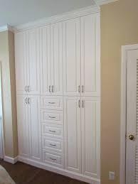 custom built in bedroom storage with classic satin nickel pulls