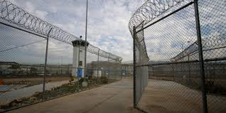 barbed wire fence prison. Prison Fences. Fence Lined With Barbed Wire