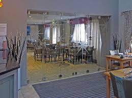 frameless glass bi fold door system in a commercial setting fraser glaze
