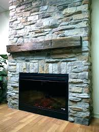 faux stone fireplace panels ing over brick