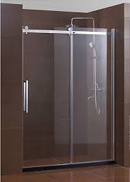 sliding glass dreamline shower door with brown bathroom walls