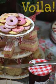 Very cool cake stand out of china tea cups and saucers.