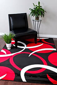 visually rich and detailed this 1062 red 6 5 round area rug is a visual feast stunning in designer colors of red black and white