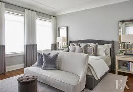 gray bedroom with ivory linen nailhead nightstands