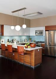 a rich stained and white mid century modern kitchen with a blue backsplash
