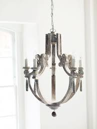 antique farmhouse chandelier with white washed wood decor 4