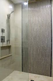 Master #shower design. Beige wall #tile with gray glass mosaic. #ideas