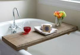 Remember that weekend trip we made to Restore in search of a reclaimed  board? Well, this rustic-modern bath caddy was the end result of our hunt   and the ...