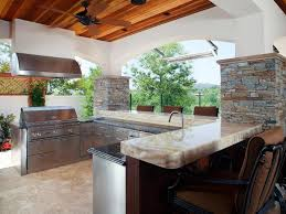 small outdoor kitchen design with vent hood and granite countertop using ceiling fan