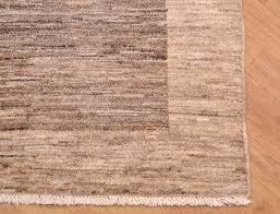 modern afghan grey rug with plain dark grey two panelled design on a lighter grey background