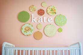 classy baby room decor wall art with round shape pattern canvas picture and white nursry baby cribs decor idea