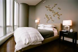 gold and gray bedroom with gold art