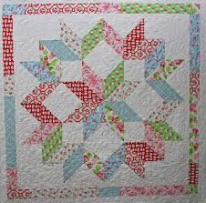 Pin by Martha DeHoop on Half Square Triangle Quilts | Pinterest ... & This link doesn't go to the quilt but I think it is the Moda Love pattern  Half-square triangles - Christmas quilt? Adamdwight.com