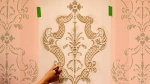 how to stencil tutorial paint an accent wall with ombre stripes damask wall stencils you